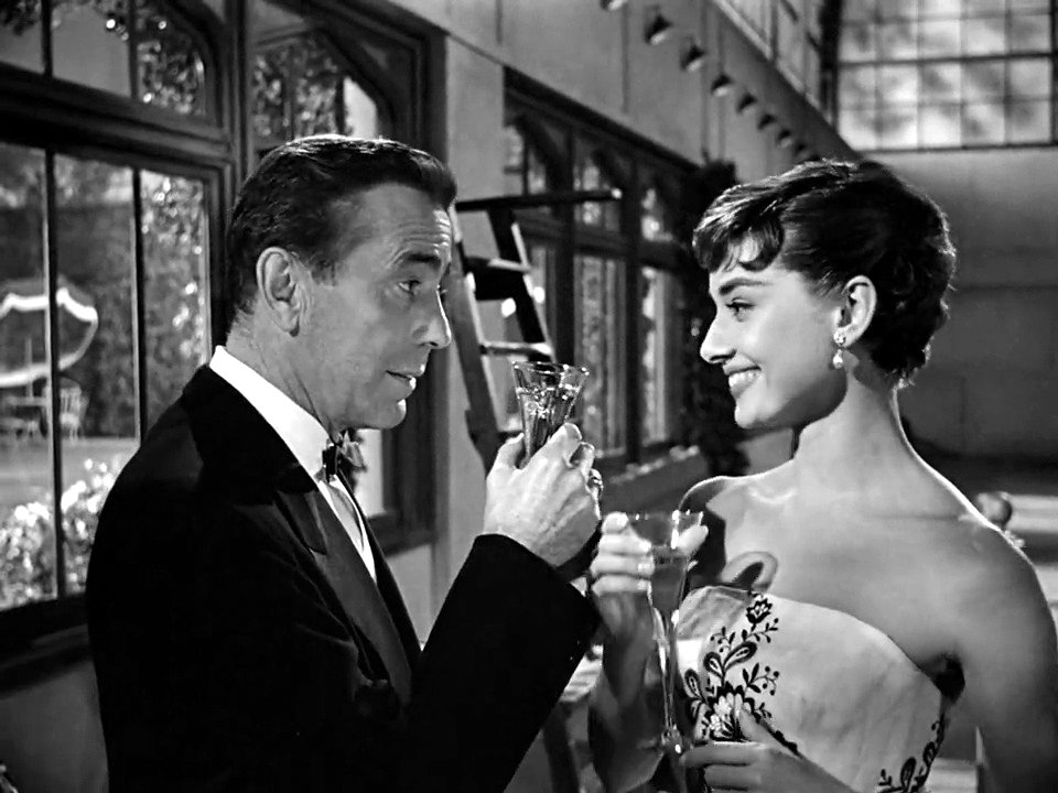 Humphrey Bogart et Audrey Hepburn dans Sabrina.